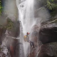 Cayoning in a misty waterfall near Manali