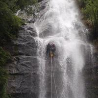 Canyoning down waterfall in Manali.