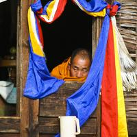 A local monk watching the festivities.