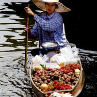 A fruit vendor at the Damnoen Saduak Floating Market, Bangkok
