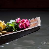 The brow off a boat decorated with roses and bananas (maybe as a offering) at the Damnoen Saduak Floating Market, Bangkok