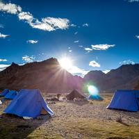 Blue tents pitched at the Dutung camp site in the Pare Chu valley.