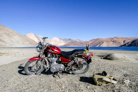 A Royal Enfield thunderbird on the Pangong Lake