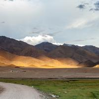 Golden light and shadows hitting the slopes of the Ladakh range.