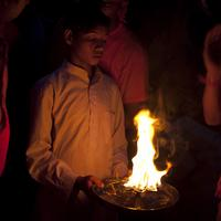 A priest offering the holy flames to the pilgrims during the Ganga Aarti ceremony at Har-Ki-Pauri in Haridwar.