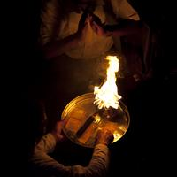Devotees pay their respect to the aarti flames and receive blessings from the priests.