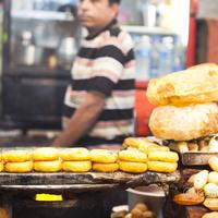 Piping hot aloo tikki (potato patties) and big fluffy pooris on offer.