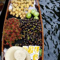 Overhead view of a fruit vendor at the Damnoen Saduak Floating Market, Bangkok