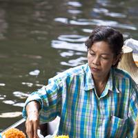 A sweet meat vendor at the Damnoen Saduak Floating Market, Bangkok.