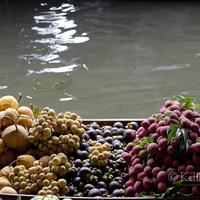 Boats laden with colorful fresh fruits at the Damnoen Saduak Floating Market, Bangkok