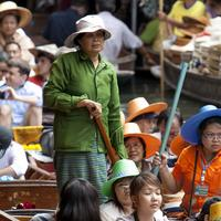 Boats laden with tourists at the Damnoen Saduak Floating Market, Bangkok