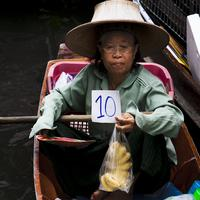 10 bhat for a dozen bananas. Not a bad deal at the Damnoen Saduak Floating Market, Bangkok