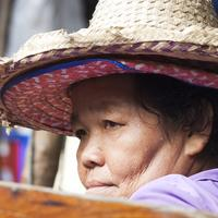 Closeup of a Thai lady vendor at the Damnoen Saduak Floating Market, Bangkok
