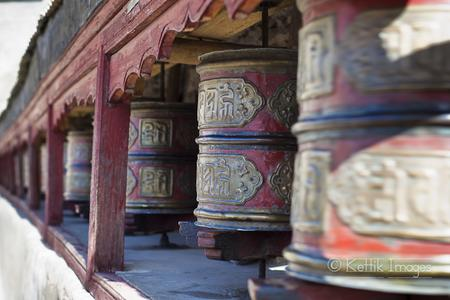 Rotating prayer wheels outside the Shey palace.