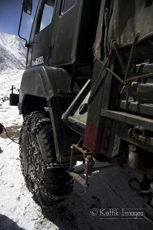 A Indian army truck with snow chains.