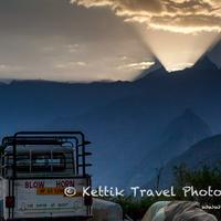 Amazing sight of the sunlight pouring out of the gap between the peaks of Leo Purgial and an unknown peak in Tibet.