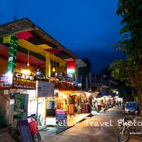 The colorful promenade of Old Manali lit up at night.