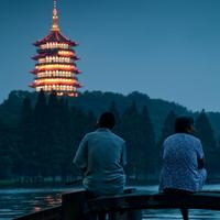 Hangzhou residents gazing at the Leifeng pagoda on a nice blue evening.